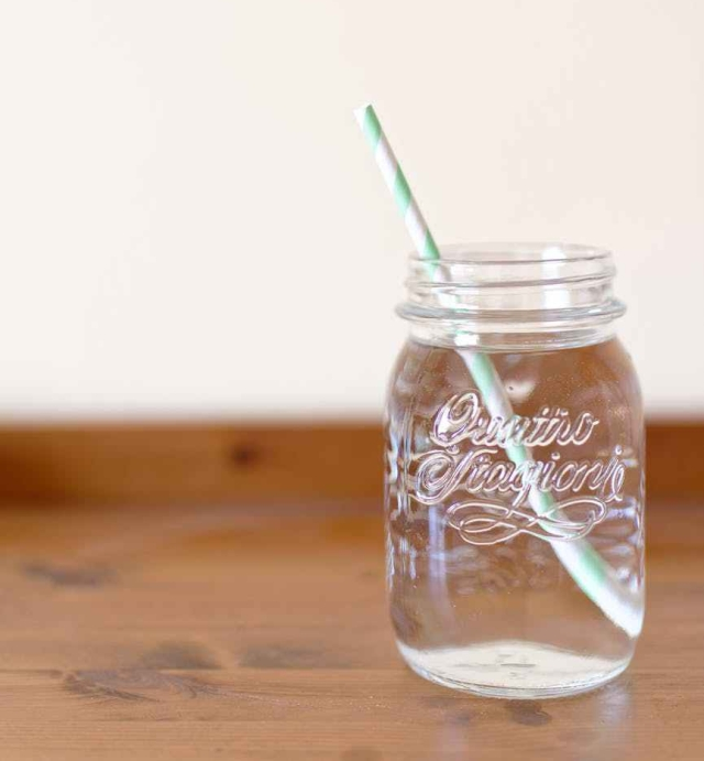 clear glass mason jar filled with water