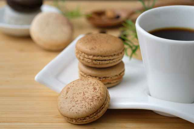 three cookies beside cup of coffee